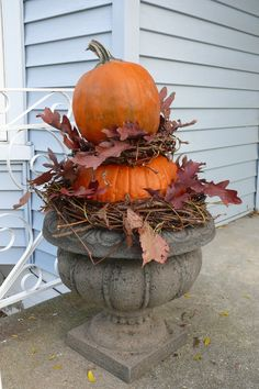 Fall pumpkin urn with grapevine wreaths and oak leaves