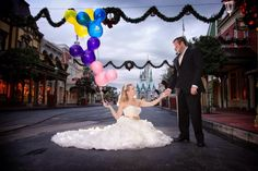 Main Street of magic kingdom during portrait session. Disney's fairy tale weddings.