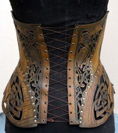 Where armor meets corset -- by Andrew Kanounov