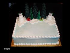 Winter Wonderland cake with snowmen and Christmas trees