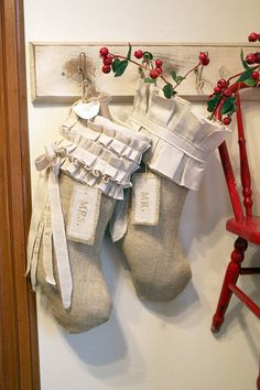 Mr & Mrs. Christmas stocking, Burlap on cotton, pleats and ruffles, bows and tassels, customized name tags. $145.00, via Etsy.