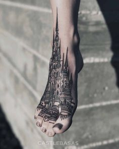 Foot tattoo castle