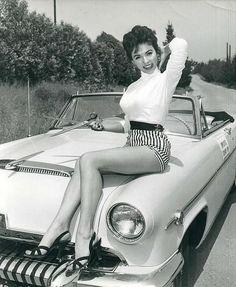 Rita Moreno on the hood of her 1954 Mercury Convertible.