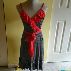 a.n.a black & white striped dress a.n.a black and white striped dress with red ruffle & wrap around belt.  Red is more of an orange/ coral red, not a blood red.  Adjustable straps.   Kick ruffle at bottom.   So comfortable and soft.  95% rayon,  5% spandex.   Size medium.    Perfect condition.  Worn once. a.n.a Dresses