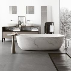 The perfect place to sink into after a long day...The handcrafted Inkstone bathtub is carved from a unique block of natural stone and hand finished to a soft, velvety touch. Neutra offer a selection of nine different prestigious stones sourced from select quarries in Italy and abroad. #NEUTRA #interiors #inspiration #interiordesign #design #bath #bathroom #stone #architects #architectural #instamood #amazing #great #madeinItaly #home #interiorluxury #archiproducts #pureinteriors…