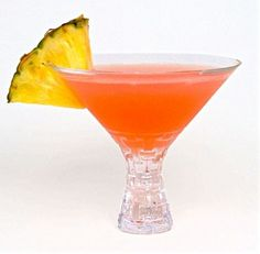 Tropical Sunset Cocktail with Van Gogh Pineapple Vodka, Van Gogh Coconut Vodka, pineapple juice, and a splash of grenadine.