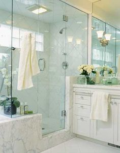 Limited wall space led to some ingenious solutions in this master bath. A chrome rod mounted to the vanity front keeps towels handy, as does a hook on the glass wall just outside the shower door. Other storage includes a bench-height ledge in the shower f Bathroom Renos, Bathroom Layout, Small Bathroom, Bathroom Ideas, Bathroom Plants, Bath Ideas, White Bathroom, Bathroom Renovations, Window In Shower