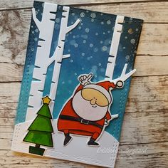 Christmascard with MFT Jingle All the Way, Dienamics Birch trees and Distress inks.