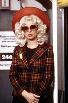 """Henrietta Robbins (Barbra Streisand): """"Borough Hall. Heavy woman. Red hat. Blonde wig. Sunglasses. Yellow shopping bag. Don't make a mistake."""" -- from For Pete's Sake (1974) directed by Peter Yates"""