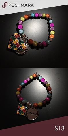 """Autism Awareness """"Blessed"""" Bracelet Orange, Yellow, Purple, Pink, Blue & Silver beads strung together on a strong, stretchy elastic string w/ silver plated autism awareness pendant & """"blessed"""" pendant. Jewelry Bracelets"""