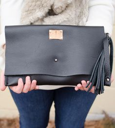 Black Leather Clutch Wristlet   Dangle this black leather clutch from your wrist, tuck it unde...   Handbags