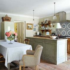 """[i]The kitchen island demarcates an informal dining area.[/i] Like this? Then you'll love [link url=""""http://www.houseandgarden.co.uk/interiors/kitchen""""]Browse hundreds of inspirational kitchen design ideas »[/link][link url=""""http://www.houseandgarden.co.uk/interiors/bathroom""""][/link]"""