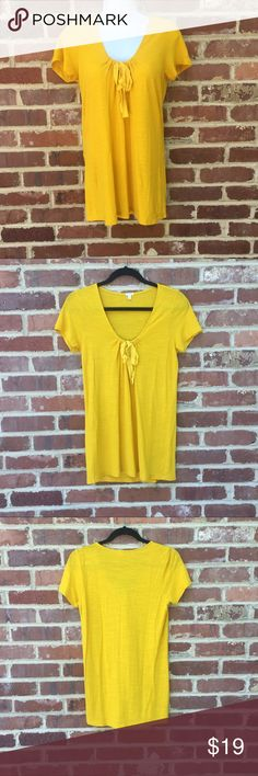 "J. Crew Top T-Shirt Ribbon Neck Yellow Knit J. Crew Top 	•	Yellow 	•	Excellent condition 	•	Grosgrain ribbon at neckline 	•	Size Small 	•	60 cotton/40 modal 	•	Approx. Measurements: 27""long; 16"" across armpits; 14"" across shoulders J. Crew Tops Tees - Short Sleeve"