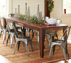{ love the rustic farm table, w/ those chairs }