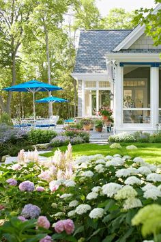Extended use  Screened patios extend your season outdoors and transition to patios. Plantings of hydrangeas echo the blues in the seating area and white of this Door County, Wisconsin, home.
