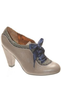 """Classically adorable, this little bootie can be dressed up or down for a timeless feminine fashion statement.    Leather and suede upper, fabric lining, rubber sole, 3 1/4"""" heel."""