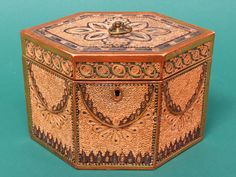 Finest quality hexagonal quillwork tea caddy, c.1780, England, with wonderful details including swagged side panels and original painted (pink) interior lid. Rolled Paper/Quillwork