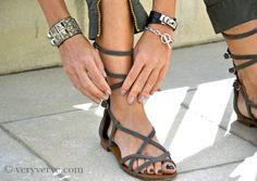 #Chanel #Gladiators sandals. Hermès Collier De Chien cuff bracelet in lizard Natural ombre, Hermès black Kelly Double Tour bracelet, Hermès Chaine D'Ancre bracelet.
