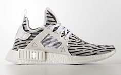 ca1d79831cba5 The popularity of the extremely limited edition adidas Yeezy Boost 350 Zebra  inspired this latest iteration of the adidas NMD as it s set to debut next  ...