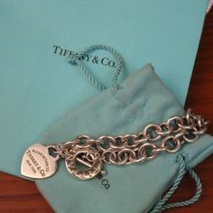 Return to Tiffany Heart Toggle Bracelet Large length T&Co. Bracelet purchased at the Tiffany's in Northbrook Illinois. Comes with a bag and the dust bag as pictured. Minor scratching from wear but can be brought into any Tiffany's store for cleaning/repair. Tiffany & Co. Jewelry Bracelets