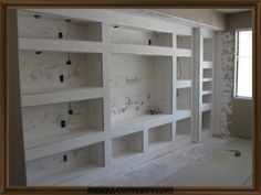 showing a big entertainment center after its been framed, drywalled and textured ready to paint