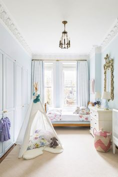 We LOVE this blue classic children's bedroom from designer Cece Barfield Thompson's NYC home