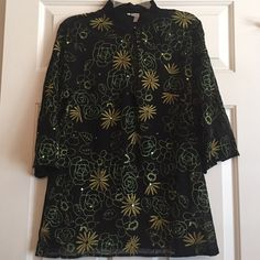 """💐NEW Silk Embroidery Sheer Boho Tunic Kimono Top Gorgeous! 🌟BUNDLE SALE 25%-30% OFF!🌟Contact Me For Discount!🌟New without tags. 100% Silk, black tunic is slightly sheer with gold and green embroidered floral designs. Sequins are scattered about and flash sparkle when you move! Pretty rhinestone toggle fastens at high neckline.  3/4 length sleeves with 1"""" open slit at bottom of sleeve. 2"""" Side slits at side bottom of hem as well. Measures 18"""" across front (36"""" total) NO STRETCH! Length…"""