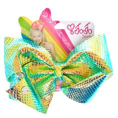 """<P>Create a magical unicorn look with this big and shiny hair bow. The mesmerizing bow comes in a snake skin pattern and iridescent shine finish. Add this unique bow to your JoJo Siwa bow collection</P><UL><LI>JoJo Siwa Collection<LI>Metal salon clip<LI>8"""" W x 5"""" H<LI>1 Pc</LI></UL>"""
