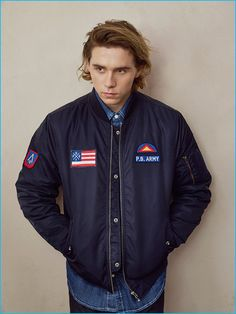 Brooklyn Beckham dons a sporty bomber jacket from Pull & Bear.