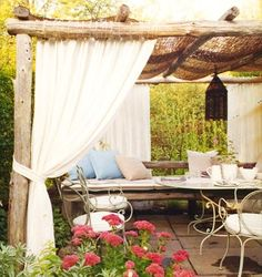 something romantic about sheer white curtains draped outdoors.