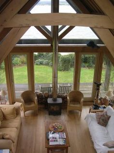 View of Barn Room with woodburner from gallery, by Roderick James Architects