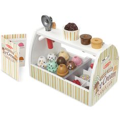 Encourage pretend and imaginative play with the Scoop & Serve Ice Cream Counter toy from Melissa & Doug. This set includes a scooper, cones, dishes, and a variety of ice cream flavor scoops, plus a menu. Measures x x Scoop & Serve Ice Cream Counter Ice Cream Playset, Play Ice Cream, Ice Cream Scooper, Bebidas Do Starbucks, Play Food Set, Play Sets, Play Kitchen Sets, Ikea Play Kitchen, Melissa & Doug
