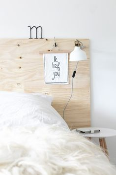 I really like the idea of a plywood headboard ♡