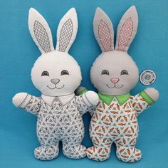 """""""Bunny in Pajamas"""" is a Cut and Sew fat quarter project that is available in black and white or color. The instructions are printed on the fat quarter. You only need fusible fleece for the ears and stuffing to complete these 14 inch tall bunnies. Also check out my bears, cats, and dogs. Link in Profile is for my Spoonflower shop."""