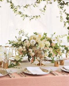 Lovely, low centerpiece with wildly-elegant organic style- wrong colors but right idea- the container is good too