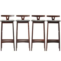 set of four rosewood stools. love the low back on these.