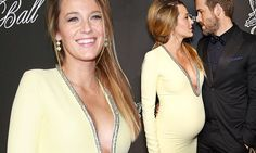 Pregnant Blake Lively gazes into her husband's eyes at the Angel Ball