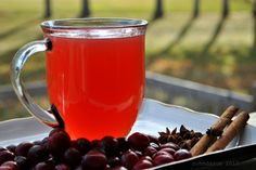 Cranberry Wassail 2 cups cranberries 3 cinn. sticks 1 tsp. whole cloves 3 Star Anise stars 2 qts water ¼ tsp Stevia Extr 5 drops Orange Oil water Put cranberries, cinnamon sticks, cloves and stars into pot and cover with 1 ½ qts of water Bring to boil Simmer for 1 hr Take a 2 qt mason jar and put filter over the mouth of the jar Remove sieve and add water into your two quart jar to reach the top Add stevia and orange oil Pour into Crock pot, leave on warm setting and enjoy