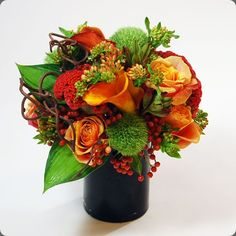 Sophisticated and unusual floral design using green trick carnations by Designs by Ann.