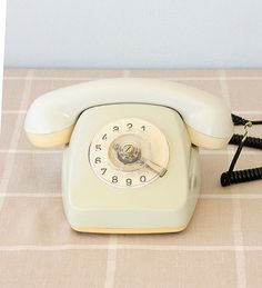 This is a vintage rotary phone probably from 1970s or 1980s.The Fetap telephones had been produced between 60s-80s.It is made in Western Germany as written under the phone. -Color is cream white.Body and handset are in good vintage condition.There is no cracks.There may be small scratches and wear from years of use.There is some very light color changes like yellowish parts. -I didnt test it ,so I sell it as is.As it is heavy (1061 grams ) and mechanically in good condition , I guess the…