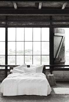 Charming loft bedroom.  Simple and serene in a neutral palette.  #whitebedding #loftbedroom