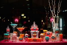 Colorful wedding candy bar for fun loving guests.  See more wedding candy buffets and party ideas at www.one-stop-party-ideas
