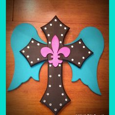 Painted Wooden cross with wings