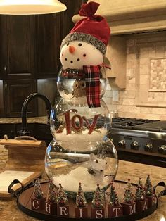 Snowman Made from Fish Bowls and Fake Snow