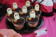 cup of dirt. Chocolate pudding w/ crumbled oreos and Milano  cookie tombstones