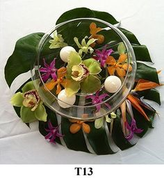 Kauai Wedding flowers - Hawaii bridal bouquets and tropical flower leis from… Tropical Centerpieces, Tropical Flower Arrangements, Beach Wedding Centerpieces, Wedding Reception Decorations, Flower Centerpieces, Table Centerpieces, Exotic Flowers, Tropical Flowers, Exotic Plants