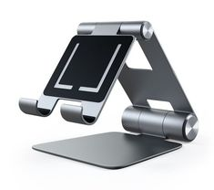 Our updated Satechi Aluminum Foldable Stand quickly elevates any mobile device or tablet for an optimal viewing experience. Home Office Setup, Desk Setup, Laptop Stand, Tablet Stand, Mac Laptop Case, Support Ipad, Tech Support, Macbook, Support Mobile