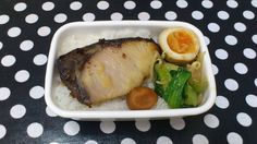 A very simple bento with a piece of miso grilled fish, a marinated egg, and some stir-fried veg. This is one working woman's bento. Nope not all Japanese bentos are cute and sweet!