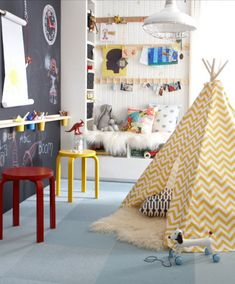 colorful playroom | chalkboard wall | red + yellow metal stools