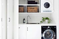 white laundry room storage ideas wicker basket and black washer dryer in laundry